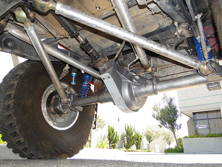 Welded to the axle tube for this double triangulated rear set up