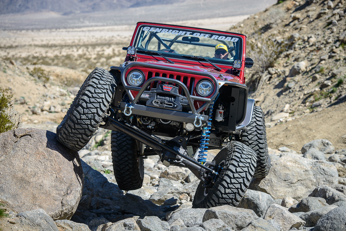 Tony testing the Tracer suspension in a 100% built GenRight Jeep LJ at the Hammers