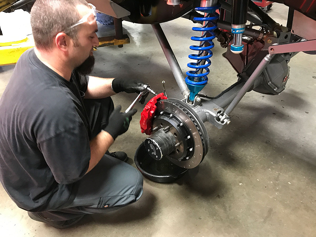 The GenRight tech installing the Alcon brakes