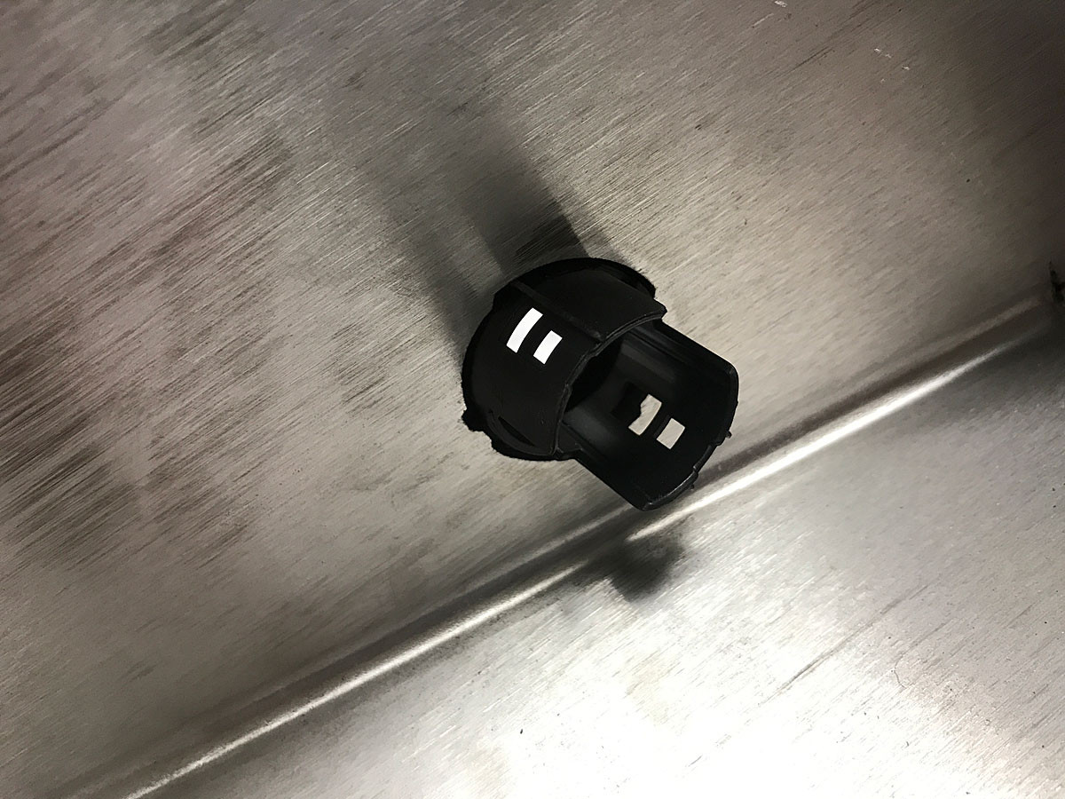 The factory Jeep bezel locks into a special shape laser cut into the GenRight bumper