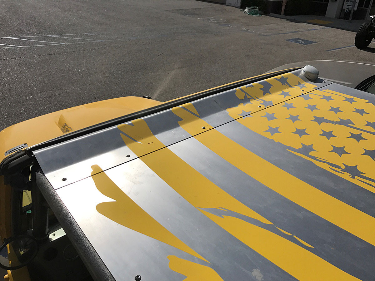 Here you can see how the filler piece presses down on the top of the windshield