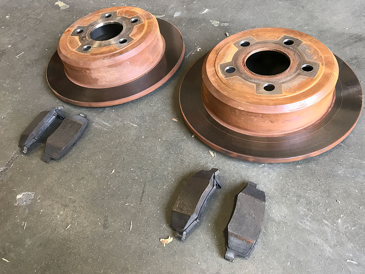 Factory Jeep JK rear brake rotors and pads
