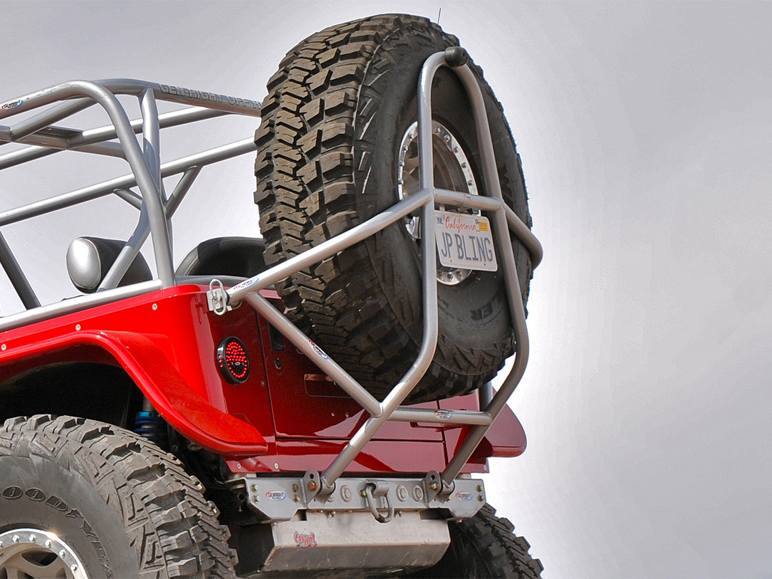 """GenRight aluminum tire carrier for the Jeep CJ with a 42"""" Goodyear"""