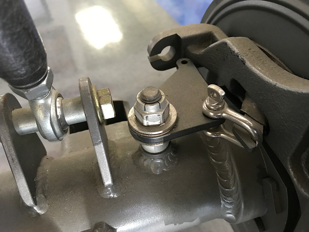 Here you can see how the bell crank attaches to the parking brake