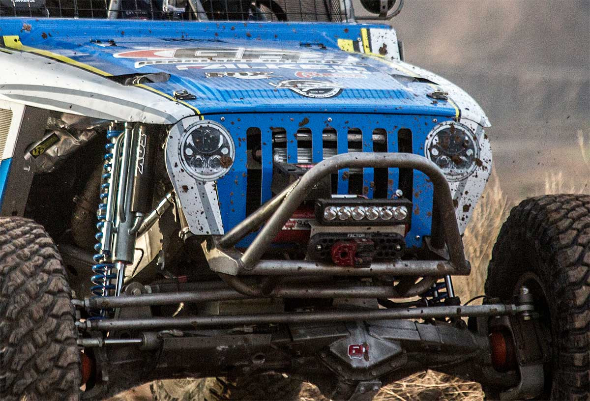 "Shown here with fake headlight ""stickers"" on the alum Jeep grille of 4500 racer"
