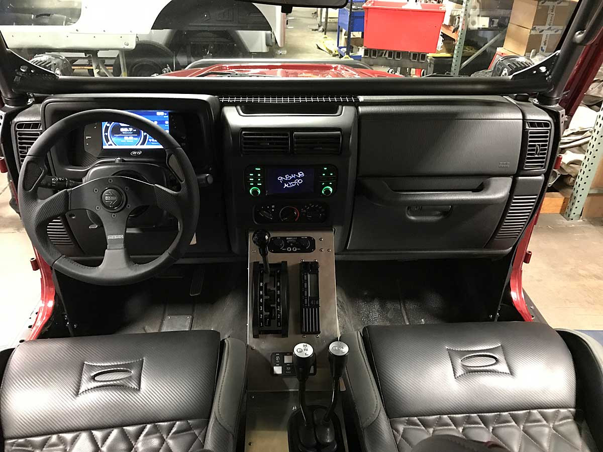 Shown here with QR steering wheel on stock Jeep column
