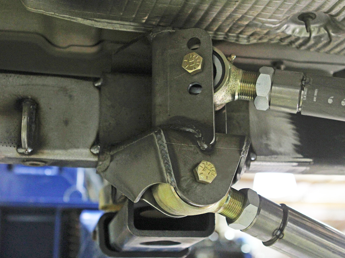 Show here is the  4 Link Rear Bracket tacked in place on a Jeep frame.