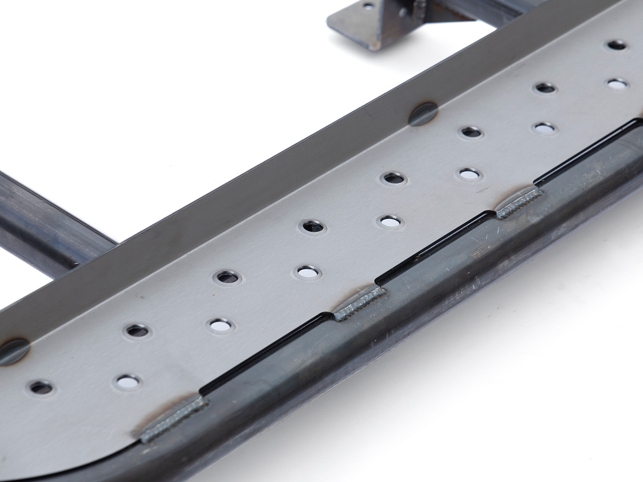 Dimple die step is MIG welded to the tube structure of the GR rocker step