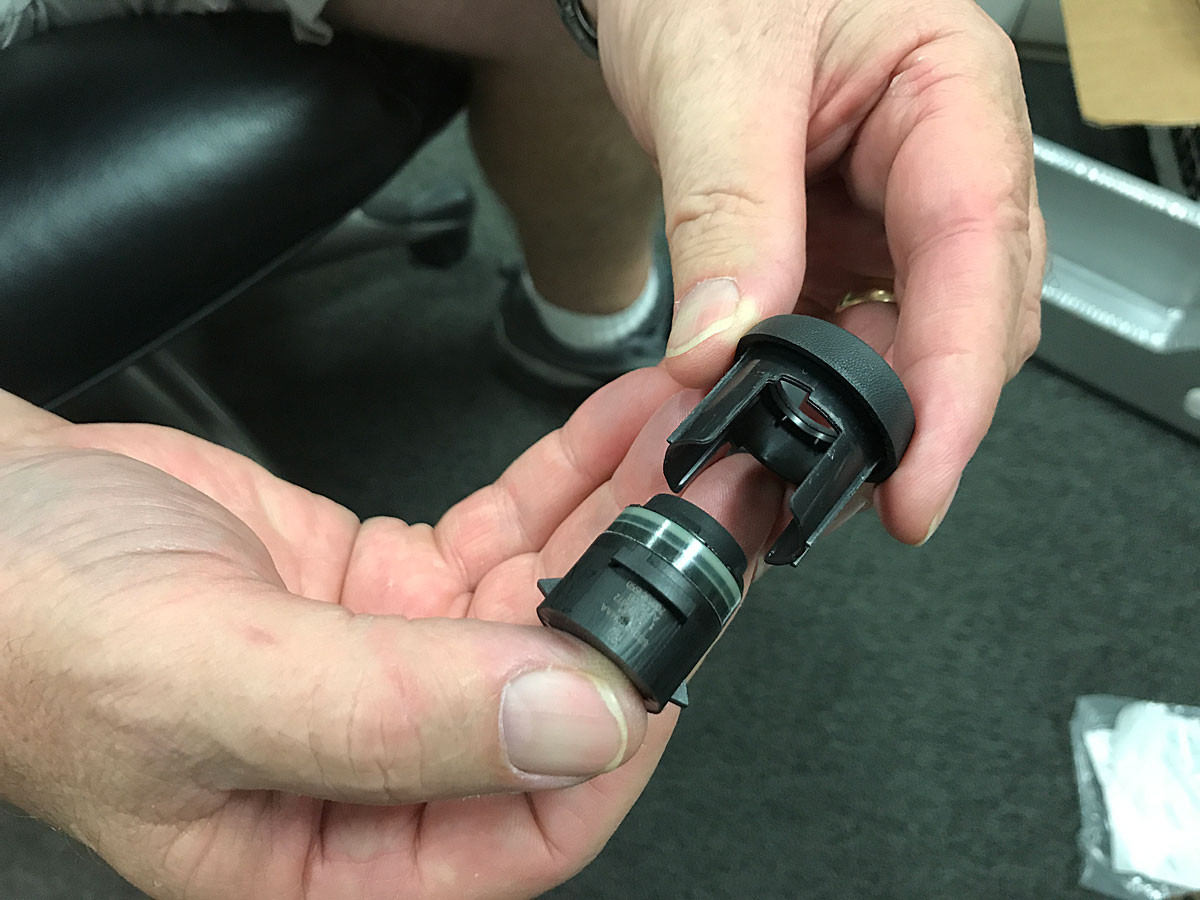 The sensor is two pieces, a bezel and a sensor. They lock into each other then the bumper.