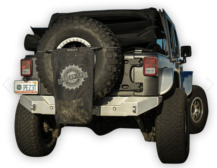 Trail Sac in Black attached to spare tire on a Jeep JK