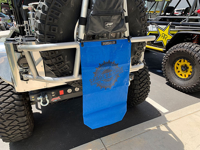 Trail Sac in Blue attached to tire carrier on a Jeep TJ