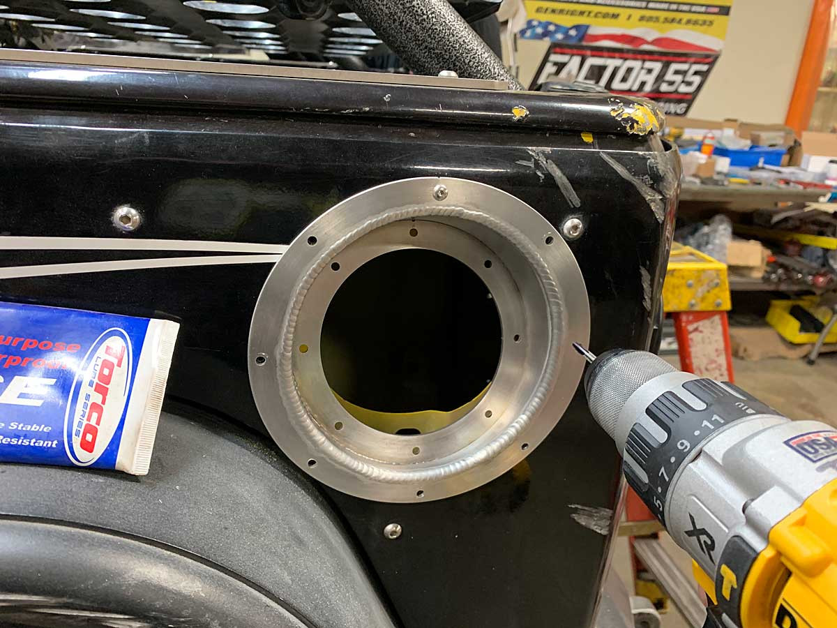 Installing the bezel on the side of a Jeep JK
