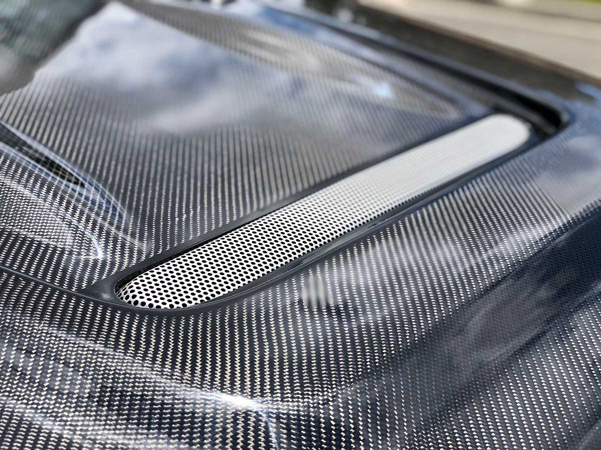 Close up of mesh on the carbon fiber heat reduction hood