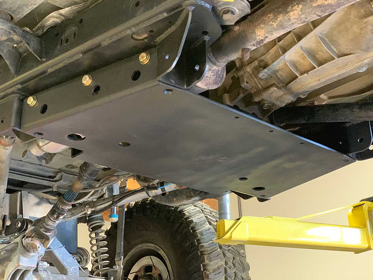 TJ Tracer frame side control arm mounts and skid plate installed
