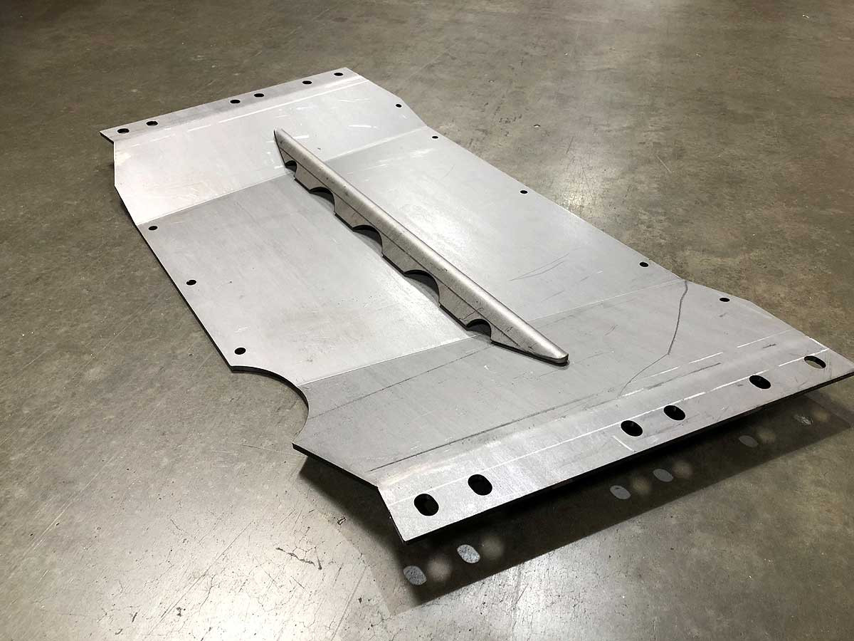 Skid plate comes with a brace that must be welded on by the installed
