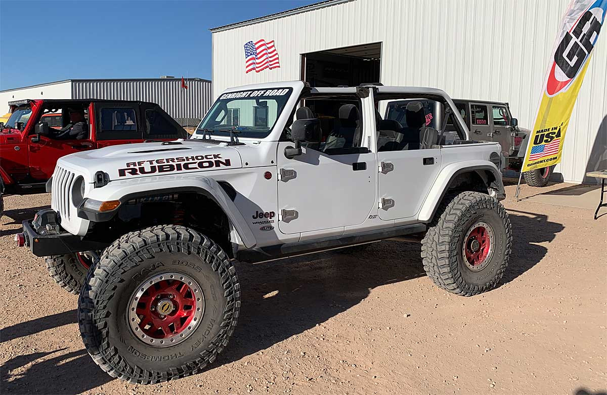 Jeep JL Wrangler half doors without the top on. Mirrors, billet hinges and arm rests are optional.