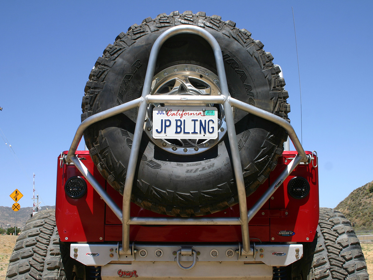 "GenRight's Swing Down Tire Carrier for the Jeep CJ pictured with a 42"" tire"