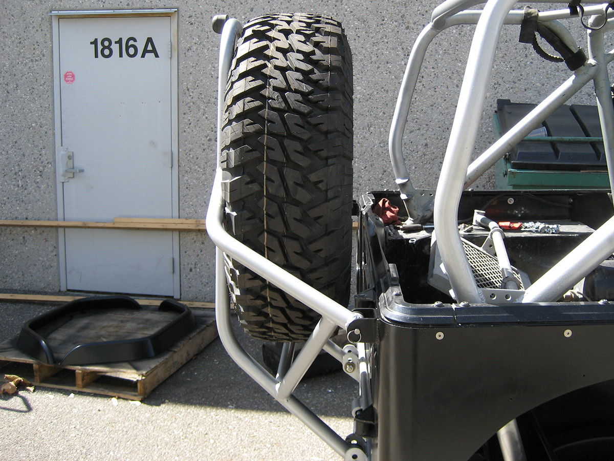 "GenRight's Swing Down Tire Carrier for the Jeep CJ shown with a 40"" tire"
