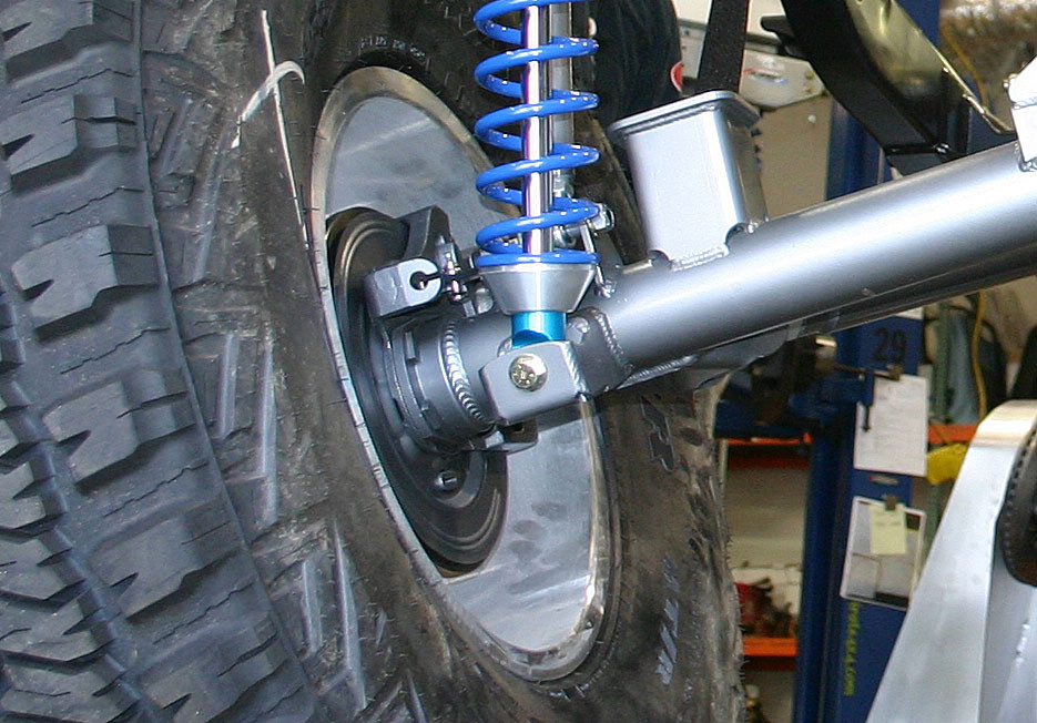 """Close up of the GenRight rear bump pad with 14"""" coil over shock"""