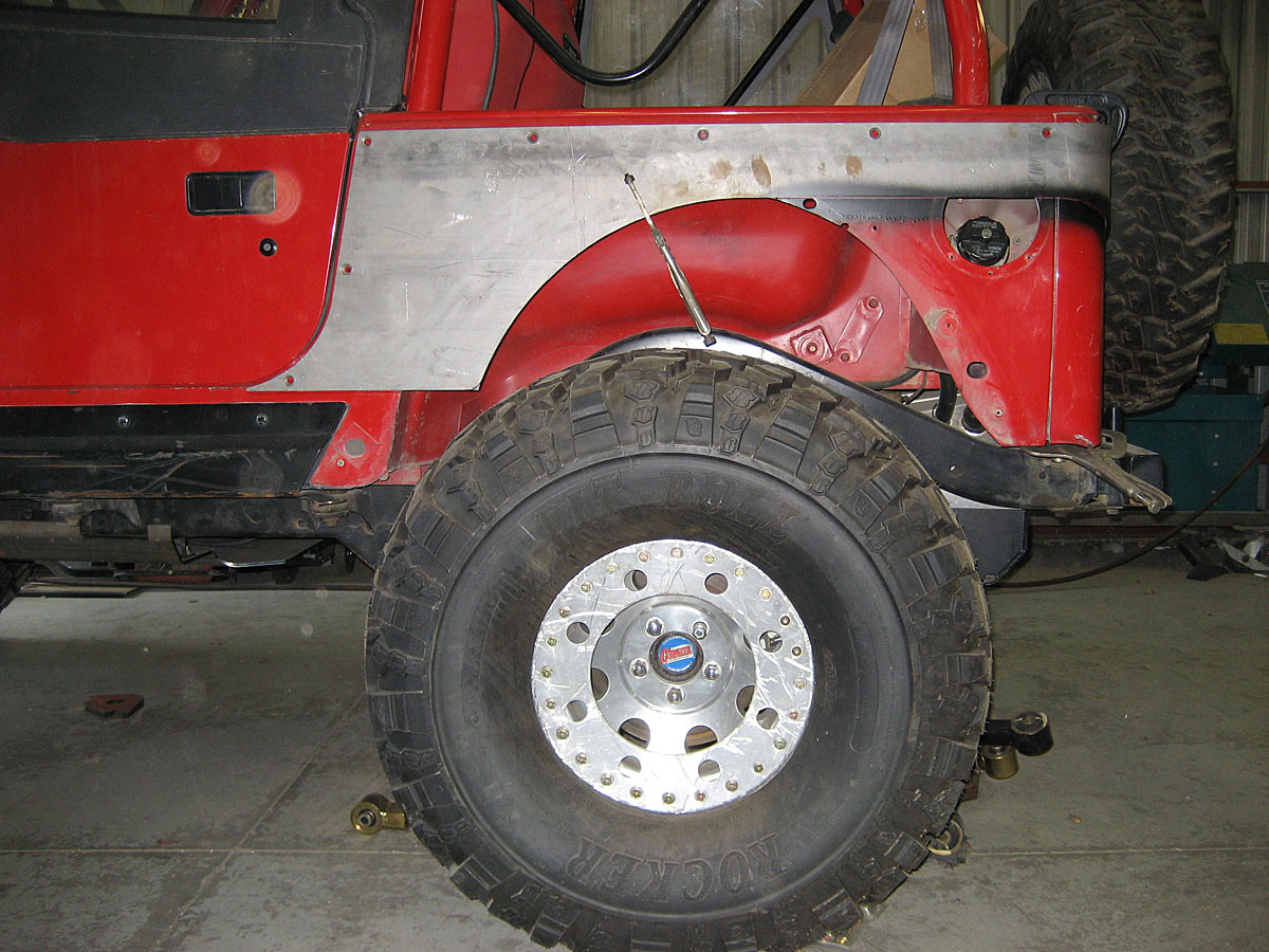 Here you can see how the corner guard panel shifts the wheel opening rearward