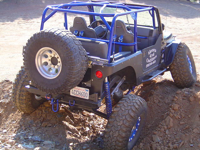 Mounted on a stretched Jeep TJ with flush mounted lights.