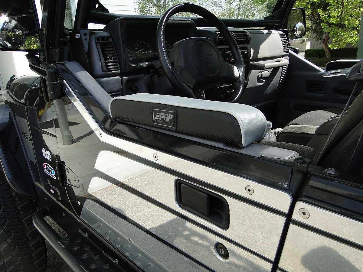 Close up of flush mount hardware on door armor of factory Jeep  1/2 door