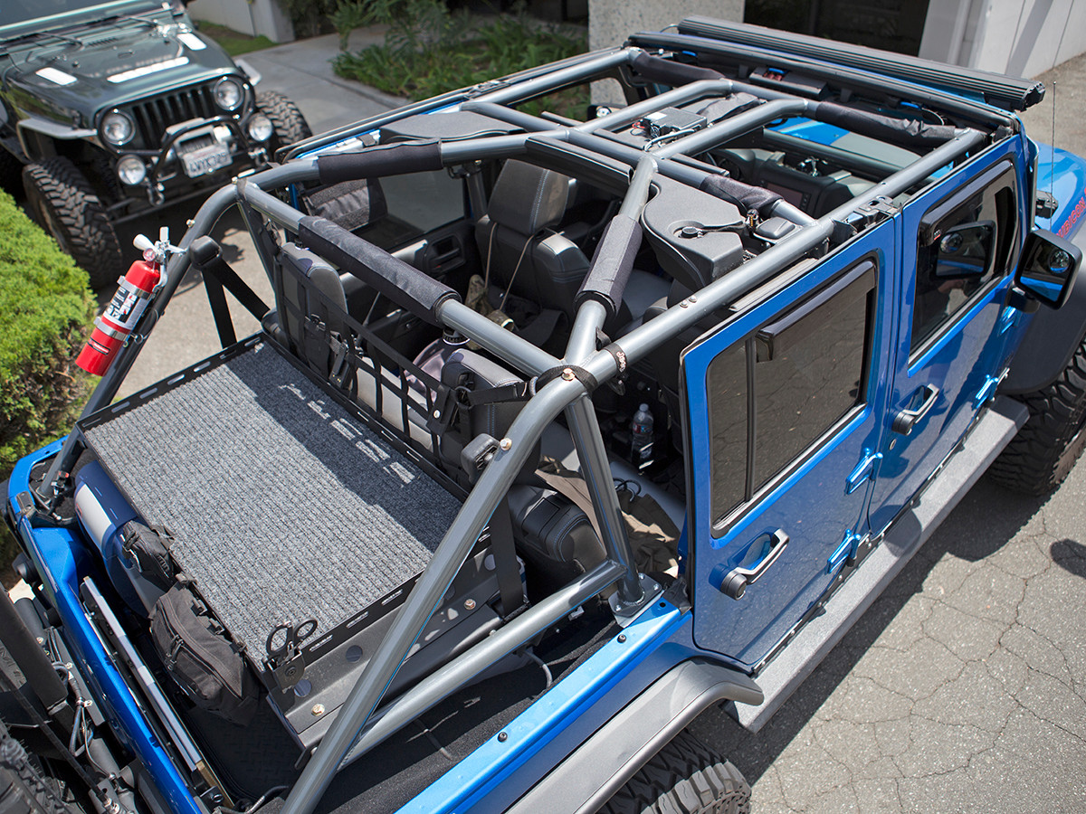JK (4 Door) Full Roll Cage Kit Installed with factory sound bar re-installed