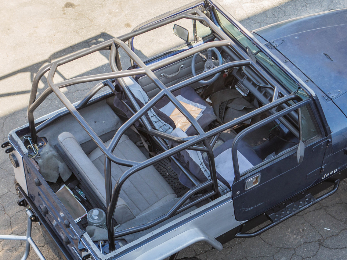 YJ Full Roll Cage Kit Shown with Optional Harness and X Bars