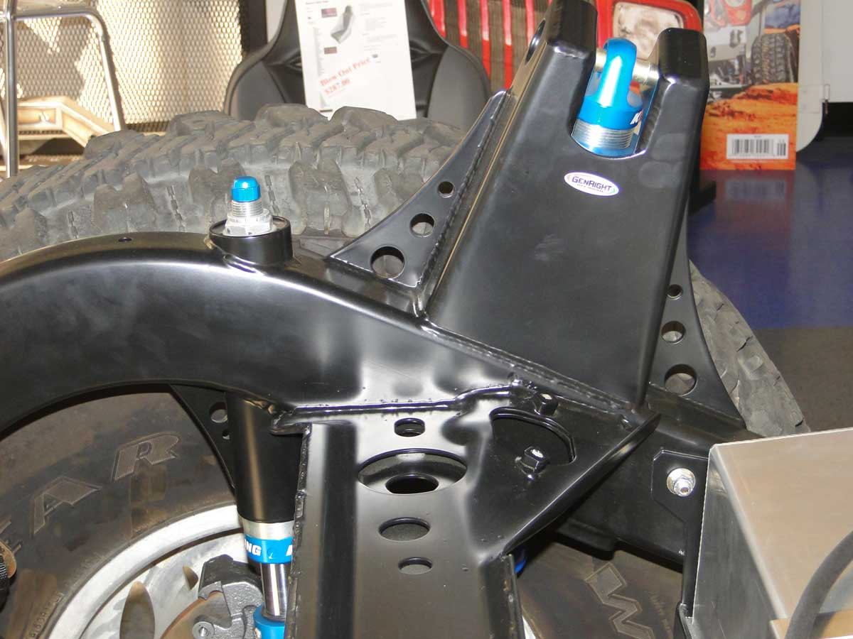 Gussets shown here on either side of the GenRight rear shock tower