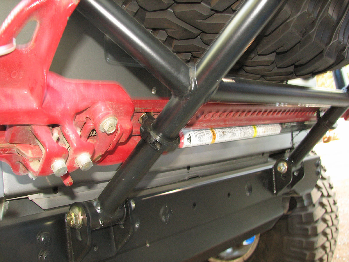 """The 1-1/2"""" dia tube clamps mount a Hi Lift jack to the GenRight tire carrier"""