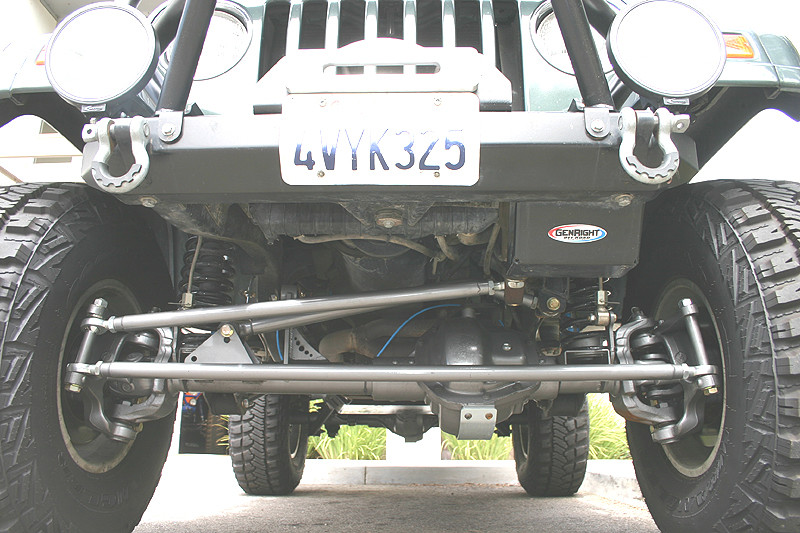 Shown here on a Dana 60 with coil springs, tie rod is lower