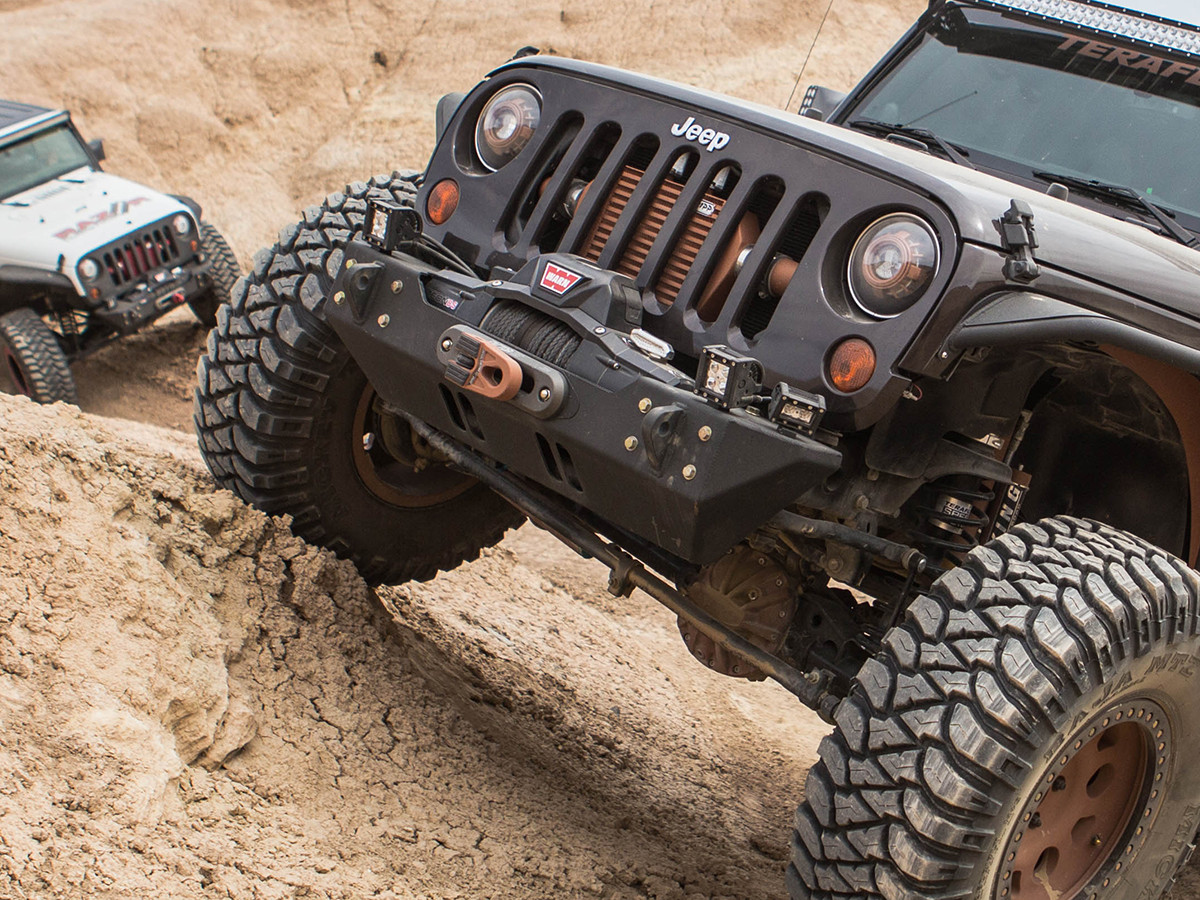 Shown here powder coated black is GenRight's Stubby Winch bumper for the JK