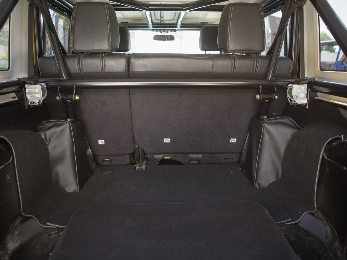 Rear Shock Towers only protrude slightly into the rear cargo are of the interior