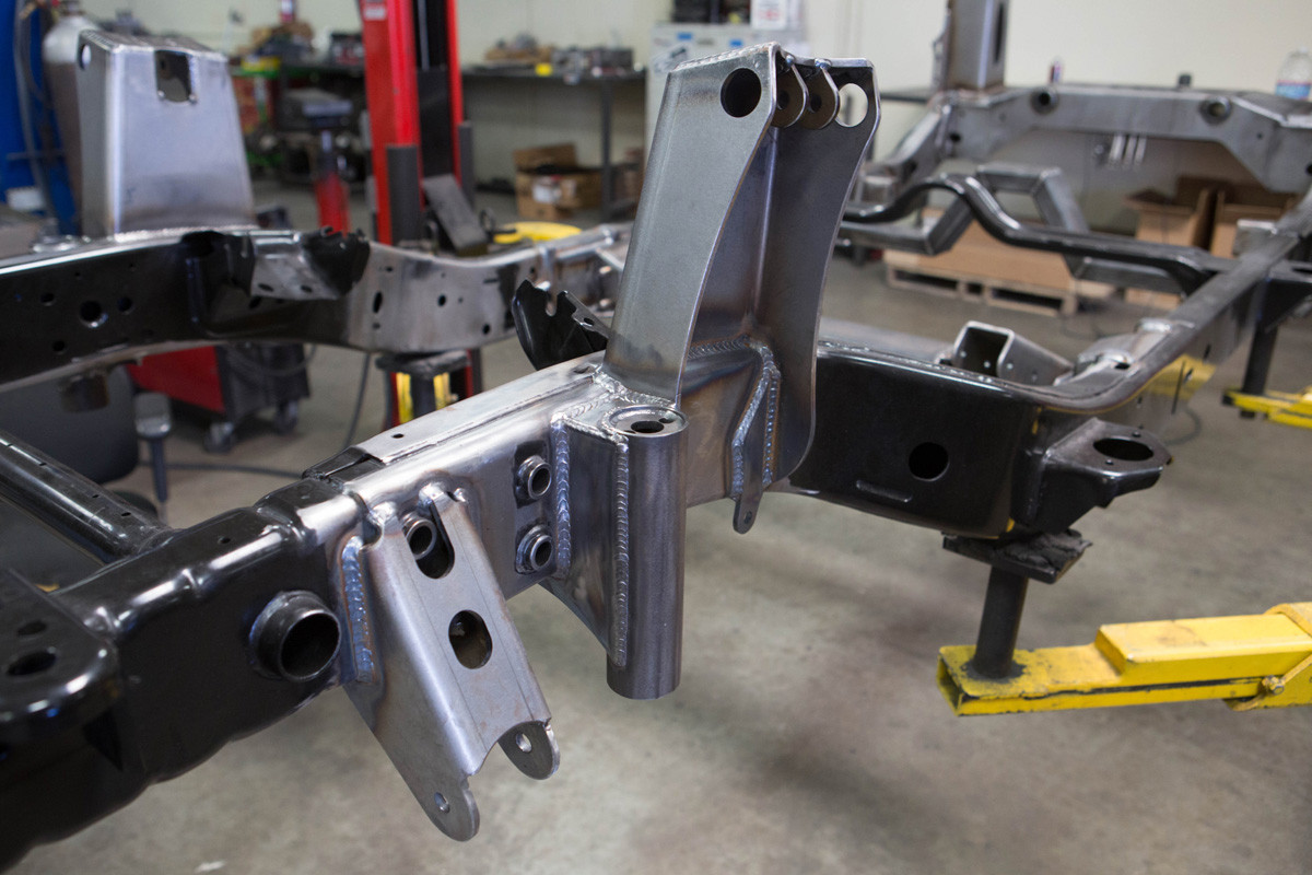 Front shock towers welded onto the frame (shown w/optional trac bar mount & bump stop can)