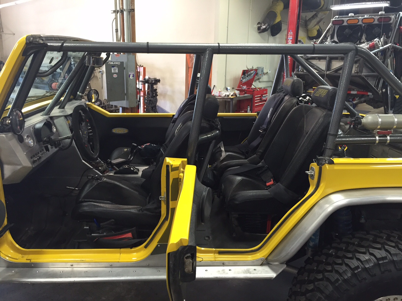 Here you can see the kit installed in a JK front & rear with PRP seats