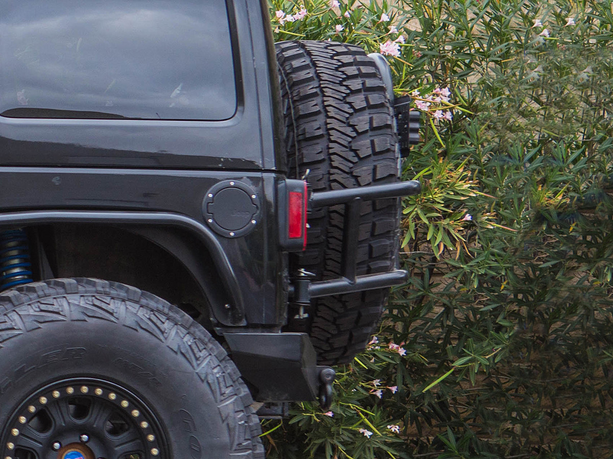 Side view shows how tight the tire fits up to the back of the Jeep.