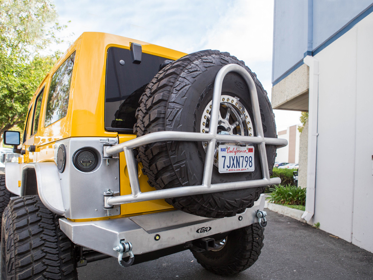 Jeep Wrangler Swing Out Rear Tire Carrier shown on Yellow-topped JK - Aluminum