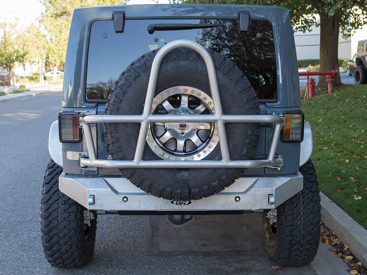 """Rear view of GenRight Alum Swing Out Rear Tire Carrier with a 37"""" tire in low position."""