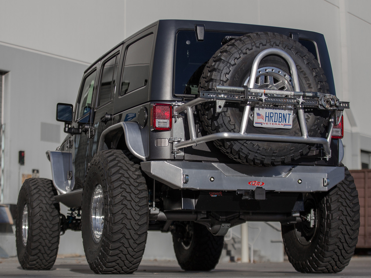 GenRight Off Road's Jeep Wrangler Swing Out Rear Tire Carrier shown on a 4 Door JK