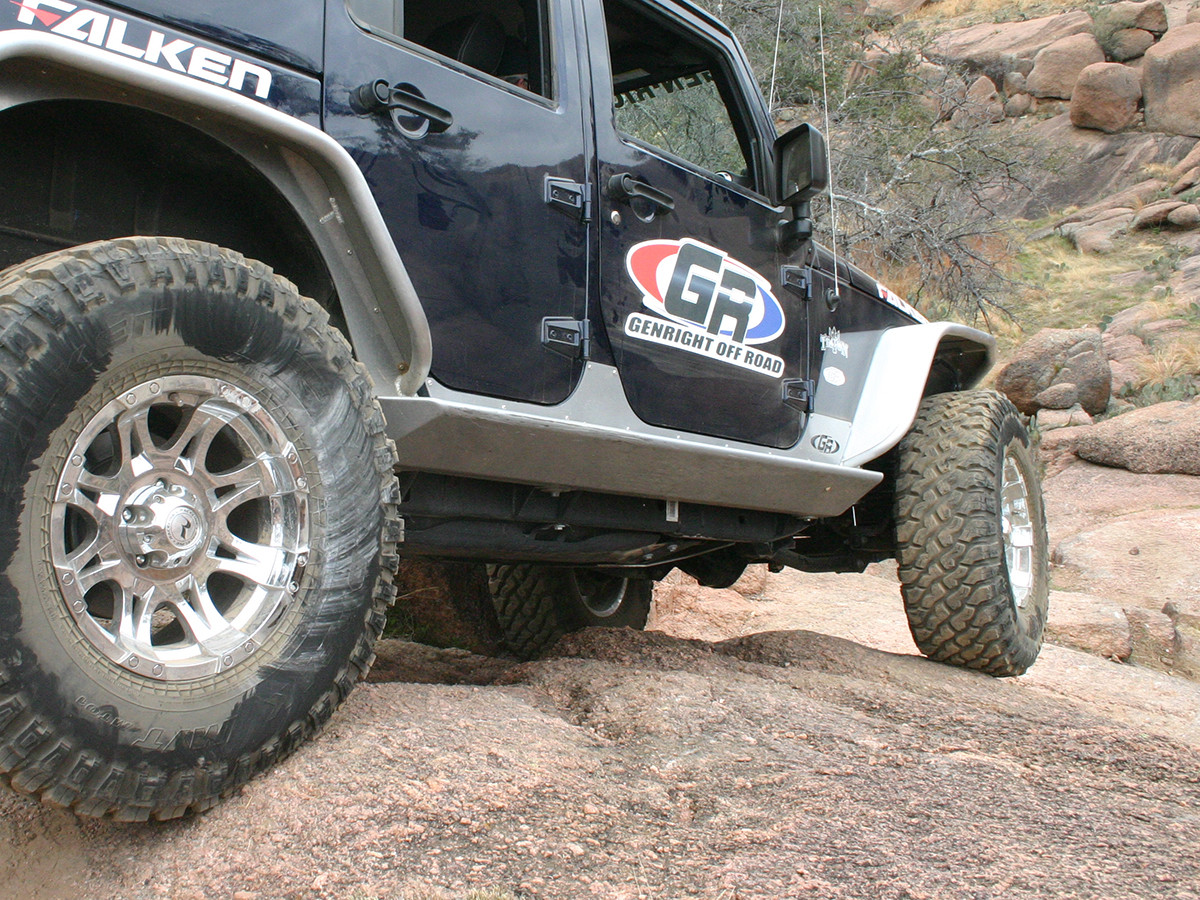 GenRight 4 Door Jeep JK Rocker Guards on a blue Rubicon