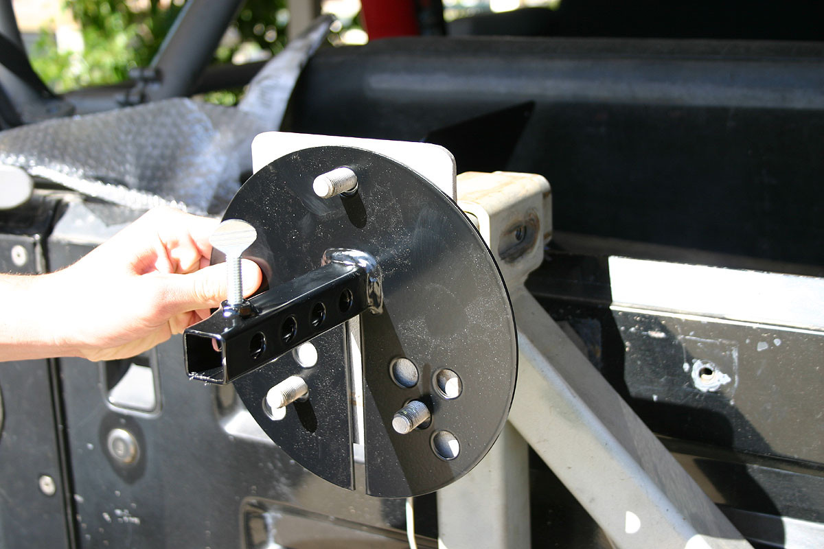 The base slides onto your tire carrier, under your wheel