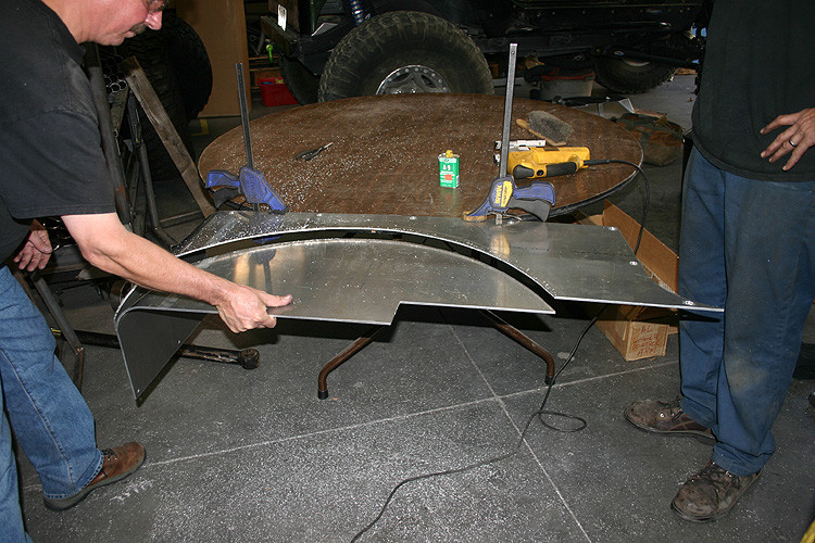 You get to mark the opening and cut the wheel opening with a jig saw where ever you want!