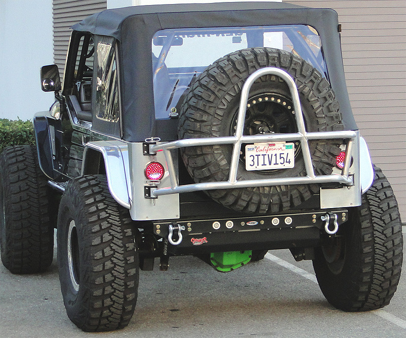 Super clean rear bumper plate is high clearance, but still has tow points
