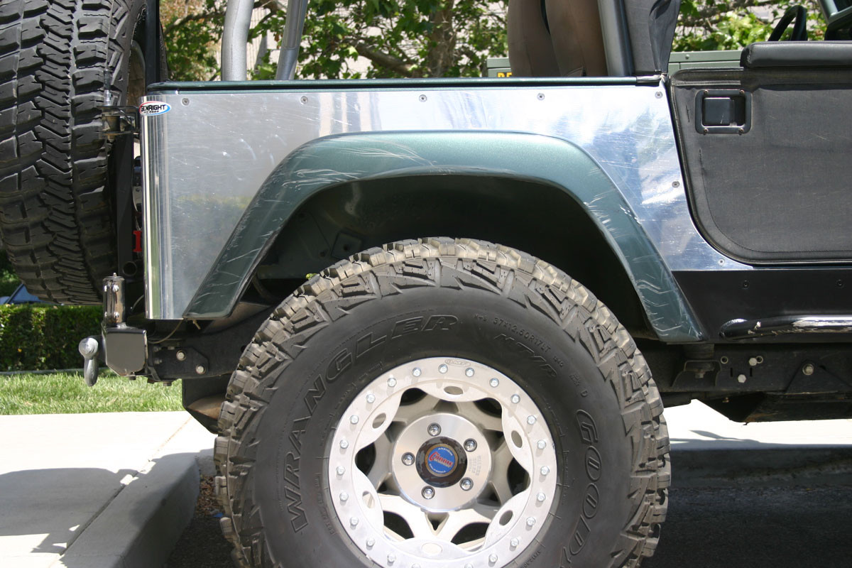 """Side view of polished corner guard with factory TJ rear flare and 37"""" tires"""