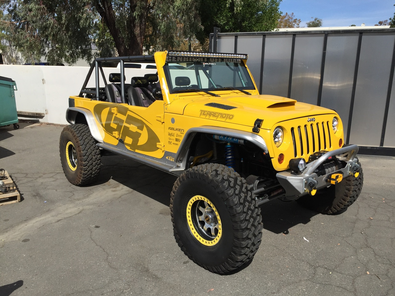 The VisionX LED light bar mounts cleanly to the top of the Jeep JK windshield.