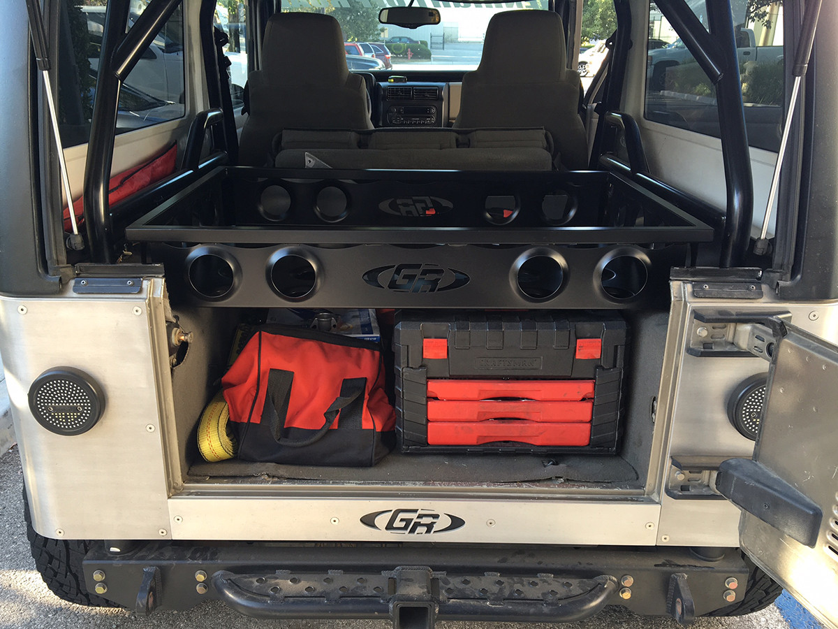 Cargo rack installed on a Jeep LJ Unlimited with a GenRight Roll Cage