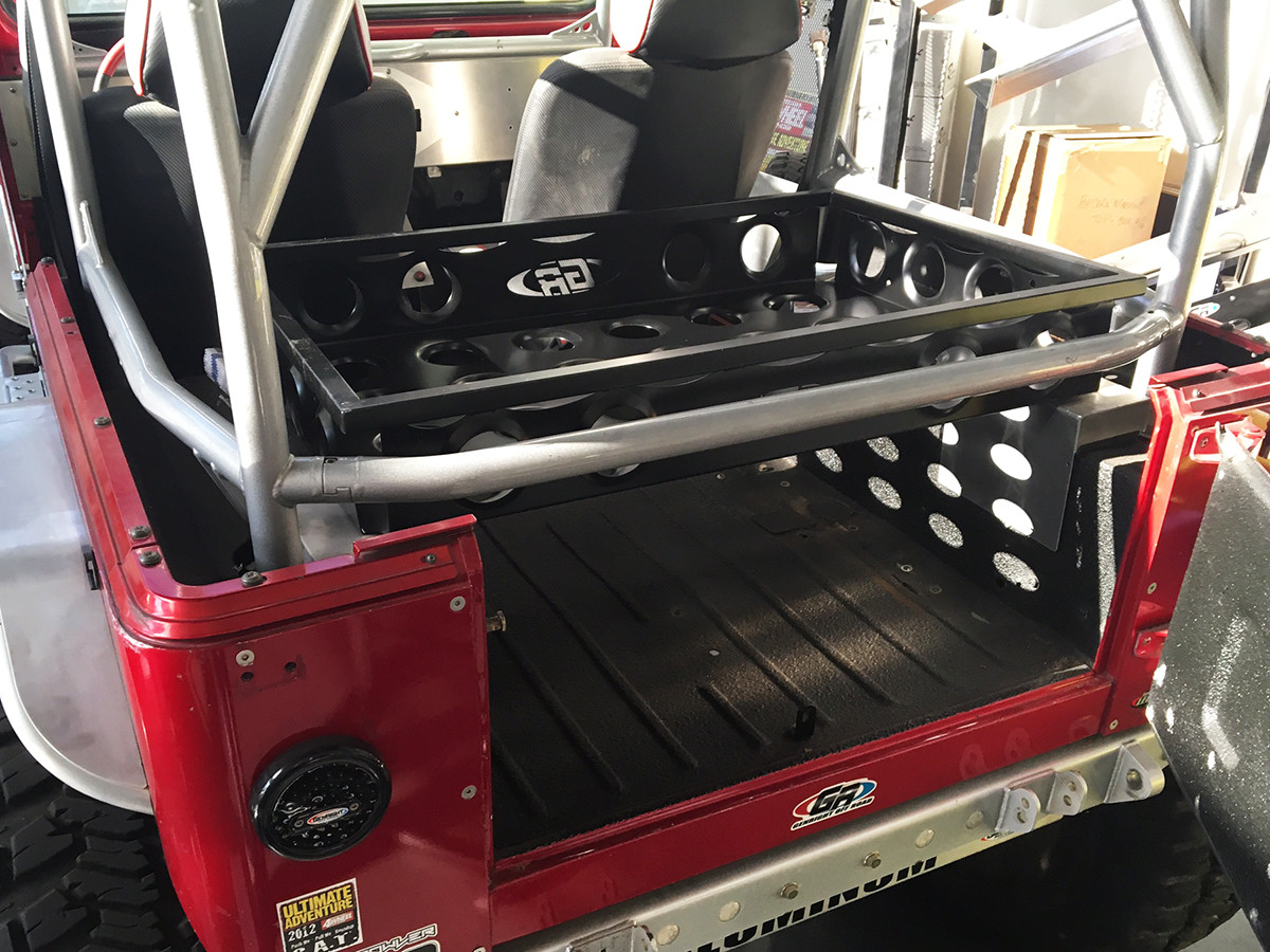 Large cargo tray installed on a Jeep Wrangler YJ with GenRight Roll Cage