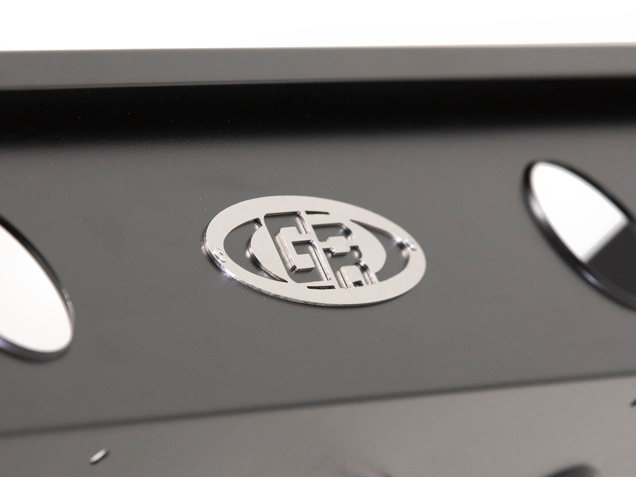 Riveted Aluminum Badge on the black powder coated finish