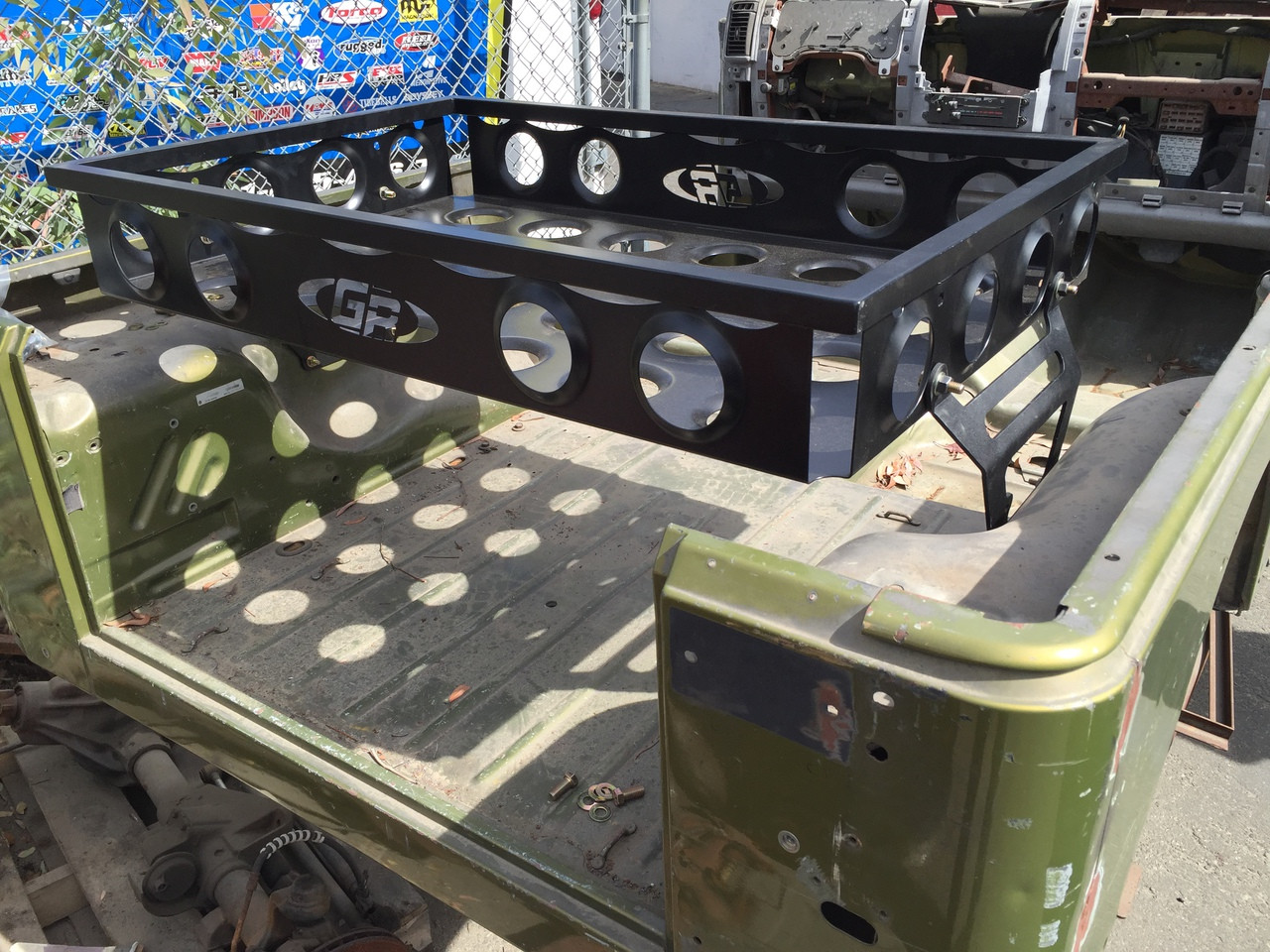 Shown here in lower mounting holes of cargo carrier in a TJ.