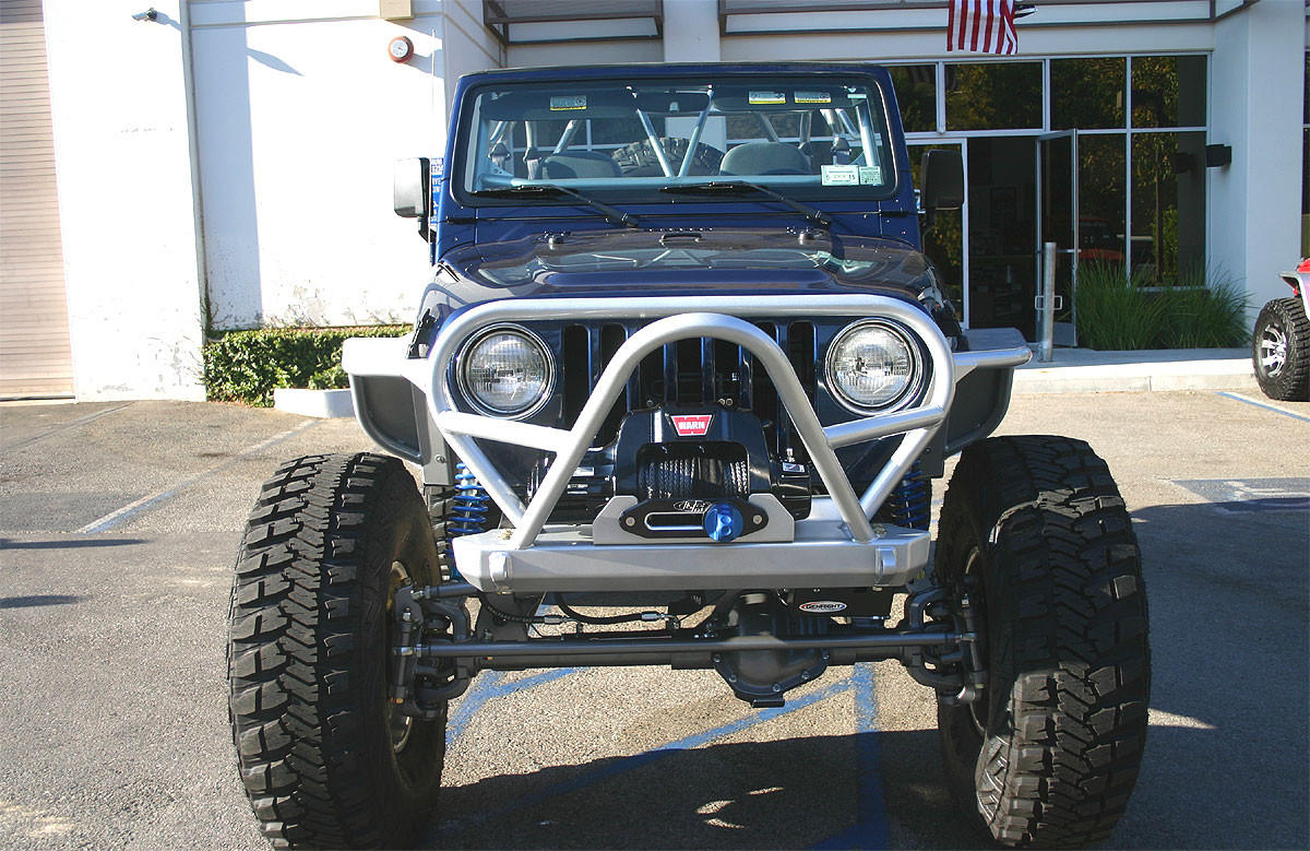 Front view of GenRight front bumper with Boulder Stinger & Grill Guard